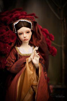 Lovely doll in Tudor raiment.