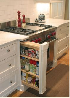 Kitchen Cabinet Storage Idea Good concept, but no point storing spices by the heat of the stove.