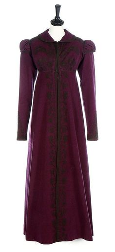 A rare purple wool pelisse robe, 1810-20 with puffed mancherons over long sleeves, raised waistline and curved collar, adorned with couched black braid, tassels to rear waist, part-lined in silk, with inner ribbon waist ties, hooks and eyes to front closure. Kerry Taylor Auctions