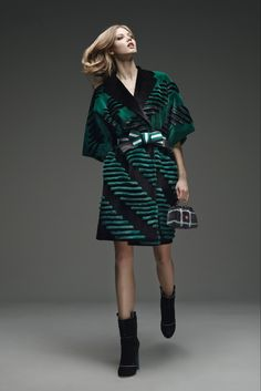 Fendi Pre-Fall 2015 - Collection - Style.com From one tiny germ of an idea—a sketch of a vintage scarf—Karl Lagerfeld created a symphony of stripes for Fendi's Pre-Fall collection. His stripes tapped a multitude of associations. In black and white, the bands could have been piano keys or something dreamed up by a Russian Constructivist. But zipped and collared like a baseball jacket and delivered in the lurid coloration of a test pattern from a 1980s TV set.