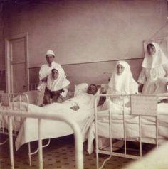 Princess Vera Gedroitz (the first female Russian surgeon),Anya Alexandrovna Vyrubova,wounded soldier,Empress Alexandra Feodorovna of Russia,Grand Duchess Olga Nikolaevna Romanova of Russia in their Infirmary at Tsarskoe Selo.