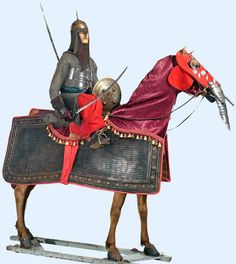 Indian armour for man and horse, the mounted figure's armour partly 17th and 19th century, the horse armour in Indian 16th/ 17th century style. Yes, that is a false trunk; war elephants wouldn't attack the 'baby elephants'- the war horses! Marwari have SUCH an AWESOME history!!!!