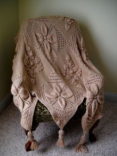 beautiful knit throw probably in a grey green shade and baby soft yarn... :)