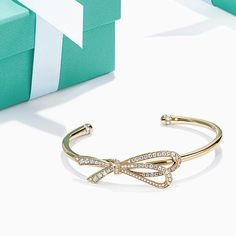Whether it's the famous white ribbon around our iconic Blue Box or the graceful diamond knot on this elegant cuff, make her holiday one to remember with #TiffanyBow. Shop the link in our bio. #ATiffanyHoliday
