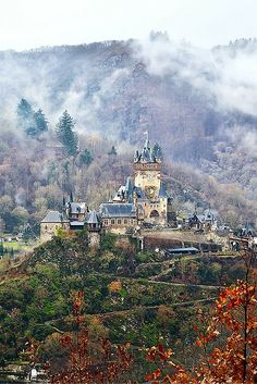 """Reichsburg castle in Cochem, Germany as it stands today was built about 150 years ago.  Even though it is """"newer"""" than many of the others on this list, the original construction was more than 1,000 years ago.  Read more on Avenly Lane Travel!"""