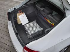 The liftback boot in the Skoda Rapid gives excellent access to the massive cargo space Car Posters, Poster Poster, Skoda Fabia, Driving Test, Baby Car Seats, Mousepad, Space, Life, Floor Space