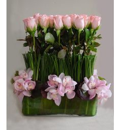 Super Chic arrangement of pink roses and pink cymbidium Orchids.