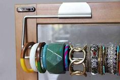 Display bracelets on a paper towel holder to keep them organized. | 41 Creative DIY Hacks To Improve Your Home