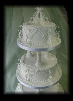 Royal-Iced_Wedding_Cake__with_piped_decoration_and_top_ornament.jpg