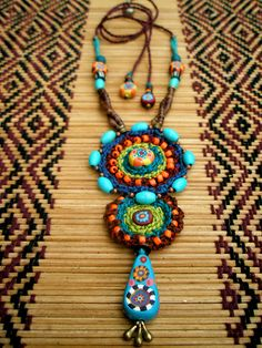 Crochet jewelry 620933867343354194 - All rights reserved Uploaded on Jul 2012 631 views / 10 favorites / 2 comments ~ My Tribe necklace ~ Source by nadinelonguemar Ruby Jewelry, Boho Jewelry, Jewelry Crafts, Beaded Jewelry, Jewellery, Jewelry Ideas, Textile Jewelry, Fabric Jewelry, Handmade Beads
