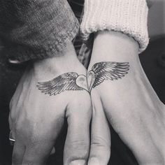 Wonderful looking complimentary couple tattoos. The design is that of a heart with wings. When joined together the symbol seems to imply that both hearts are soaring in love.