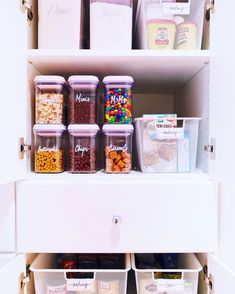 A baking cabinet with Oxo pop containers for toppings and dry goods like flour and sugar then a mesh bin for mixes.