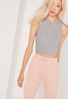 Be in charge of the off duty look in this seriously relaxed crop top. In a sporty grey marl hue, regular fit, crop style and a ring pull zip, we're teaming with light pink joggers, high rise trainers and a satin bomber jacket for an upscale. Cheap Clothing Stores, Cheap Clothes Online, Clothes For Sale, Cami Crop Top, Cami Tops, Satin Bomber Jacket, Plus Size Tops, Missguided, Casual Looks