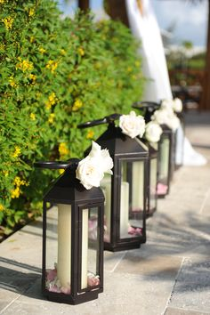 Lanterns and floral for aisle decor. You can reuse them as area decor for your reception.