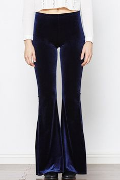 Details Made of rich velvet, these pants give off a polished look with a slight regal feel. It's cut with a bell-bottom silhouette for a cool vintage 70's-inspired look. Break the rules by mixing and