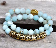 Beautiful matte blue Amazonite beads with rich antiqued gold tones. Set of 2 includes scroll design gold bar & gold disc details.    Bracelets