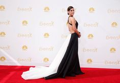 """Lizzy Caplan may not have won for Outstanding Lead Actress, but she certainly won on the red carpet! The """"Masters of Sex"""" actress looked glamorous in a black and white a Donna Karan Atelier dress with a long train and cutout back.Too much dress"""