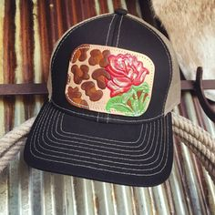 Colorful rustic painted and embossed leather patch. Black cap with tan  accent stitching. Tan mesh back.Adjustable velcro back. By McIntire  Saddlery. 26ddd54f185b