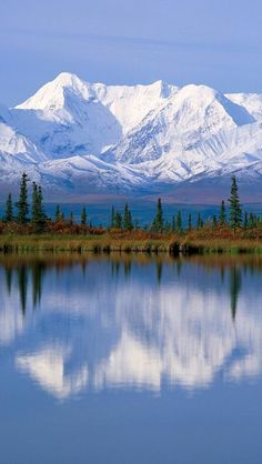 Majestic Mount McKinley massif reflected onto Wonder Lake at Denali National Park in Alaska