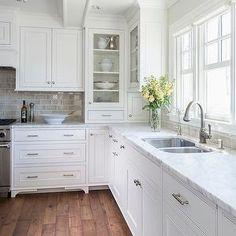 glossy tile backsplash, white cabinets