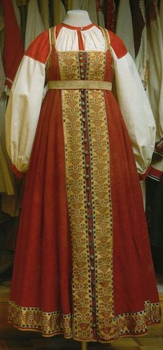 Traditional Russian dress-sarafan. White linen shirt with traditional Russian red embroidery on shoulders.