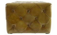 """If you like the look of leather in your décor but are reluctant to commit to a sofa or even a chair, our Asher Ottoman may be just the right fit. Fully tufted Asher is a perfect landing spot for your feet, a welcome extra seat, or, with the addition of a tray, a side table. Pair two in front of the sofa instead of a traditional coffee table or in front of the fire on a cold winter's night. Flexible Asher can be easily rearranged to serve a variety of needs.    •24""""W x 24""""D x 17""""H…"""