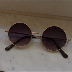 SMALL CIRCULAR SUNGLASSES  JOHN LENNON / OZZY OSBOURNE TYPE SUNGLASSES ,,,, UV 400,,, Condition: Never worn, still has sticker but no tags. Lenses: purple/brown/black shade,,, Gold/Copper Detailing. Accessories Sunglasses