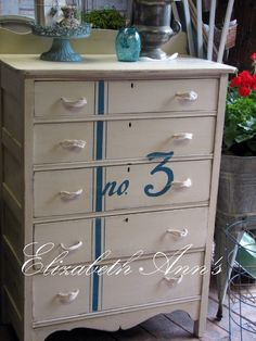 Antique chest of drawers painted with Annie Sloan chalk paint Old Ochre with the stripe and number in Aubusson