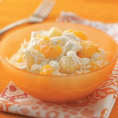 """Ambrosia Salad - This is basically  the """"6 cup salad"""" recipe.  1 cup each of canned pineapple/mandarin oranges/grapes/marshmallows/coconut/sour cream.  Make this recipe lighter and slightly different using yogurt and adding a banana & almonds."""