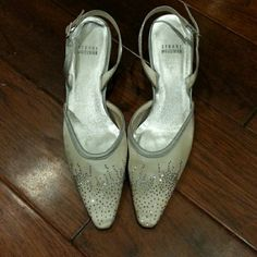 Stuart Weitzman mesh/rhinestone slingback Beautiful mesh with rhinestone slingback color is a combination of silver and a light gold pewter in the front with rhinestone applique pointed toe shoe no scuffs in great condition a small round hold at bottom purposely placed to prevent return to store Stuart Weitzman Shoes