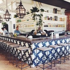 Graphic tile around the island + plants soften hard edges Graphic tiles around the island + plants s Bar Interior, Restaurant Interior Design, Mexican Restaurant Design, Mexican Bar, Cafe Bar, Commercial Design, Commercial Interiors, Pool Bar, Cafe Design