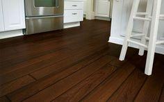 Vinyl laminate that imitates dark wooden floorboards