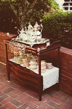 This awesome tea bar adds elegance to an outdoor wedding