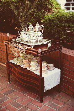 Silver tea service adds elegance to an outdoor summer wedding