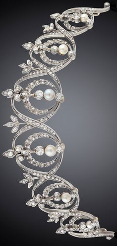 Diamond and pearl tiara, designed as six openwork motif, with hanging diamonds, pearls, with small pearls, old cut diamonds, rose cut diamonds weighing approx. 2.80 ct, 14k gold, silver, length about 12.5 cm, height 3 cm, weight 26.9 grams.