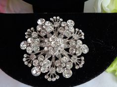 Vintage Floral Rhinestone Round Heavy Silver Tone Brooch that measures 2 inches in diameter.20% percent off and Free Shipping to the United States. in the entire store.