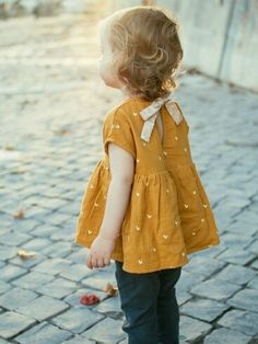 Refashion little girl's too small dress into adorable baby doll top