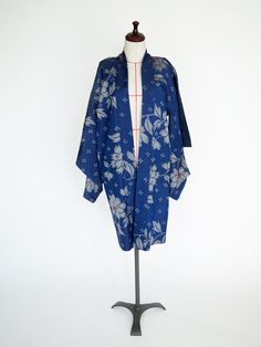 Blue Carnation Haori - Subtle, sweet flowers adorn this early 20th-century haori. It's silk inside and out, plain-weave, stencil-printed warp (hogushi-gasuri) meisen on the outer shell, flat silk on the sakura-laden lining.  Your ballgown, blue jeans or boho swirly skirt will all feel right at home with this lovely piece.  So will your decor.