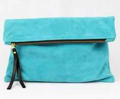 This turquoise-colored oversized fold clutch provides an exciting jolt of vibrancy on a night out; plus it keeps your keys, iPhone, e-reader, and credit card safe and snug.