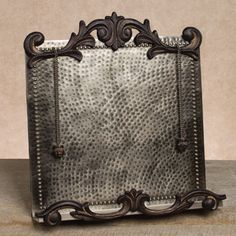 We love this beautiful Antique Silver Cookbook Holder from The GG Collection. Note the swirling acanthus leaf trim decoration and the hammered back plate, $90.00