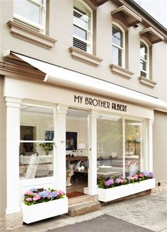Nice example of neutral color but adds pizazz with flowers Shop Facade, Lovely Shop, Cafe Interior, Shop Interiors, Store Fronts, Shop Awning, Flower Window, Coffee Shop, Window Boxes