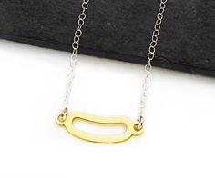 Minimalist, dainty geometric bean shape necklace in silver adn brass. Random Collection by Camillette Jewelry