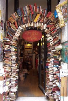 A door for book lovers! We found this picture of an archway made entirely of books... (La Bal des Ardents bookstore in Lyon, France, downtown near the Place des Terreaux)