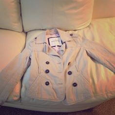 Kids Abercrombie tan jacket Tan with brown buttons and pin stripped inside. Worn about 6 times. Abercrombie & Fitch Jackets & Coats