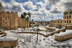 The walls of the Old City of Jerusalem after a snowy winter day.