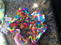 Pony bead bowl. Melt pony beads @ 400 degrees for 10-20 mins on a flat tray covered with parchment paper. Use silicone oven mitts to shape the melted beads in to a bowl or many other things. They cool quick so be fast :)