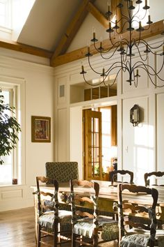 Gorgeous dining room! The juxtaposition between the classic moulding and the rustic truss is beautiful!