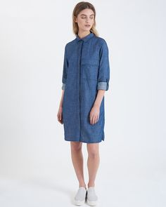 This versatile loose fitting shirt dress is cut from a soft and lightweight chambray fabric. Buttoning down at the front it also features a large breast pocket, tab fastening roll up sleeves and two side pockets. By Atterley Road.