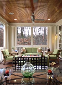screened in porch/sunroom.   How amazing would it be to have this open to the livingroom, then open to a deck. Maybe put windows that could slide down so it was open air during the summer, but could stay warm for the winter.