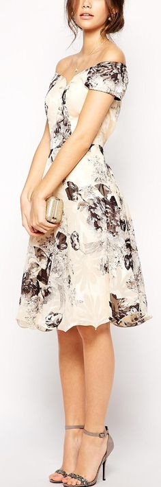 This print is to die for. I probably wouldn't go for off the shoulders but the a-line is perfect.